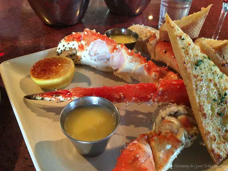 Mouth Watering Fresh King Crab Legs with Butter and Bruleed Lemon at Seatown Seabar in Seattle