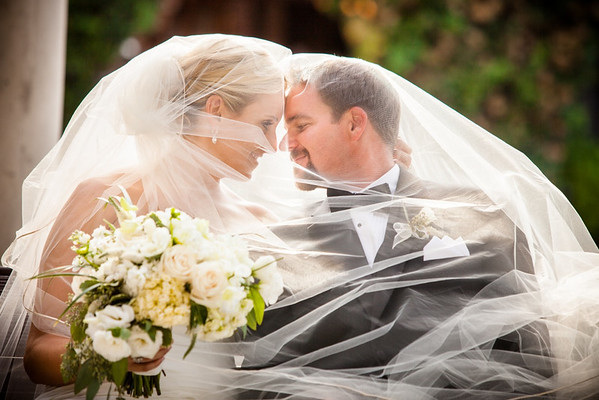 Bride and groom in veil by Dane Sanders
