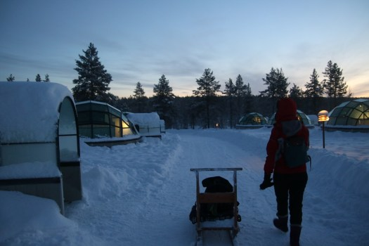 luggage sled to glass igloos in kakslauttanen