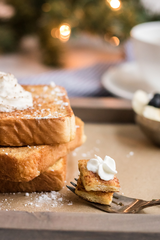 This Eggnog French Toast recipe is the most perfect recipe for Christmas morning, and for all of winter! Enjoy the festive spices and perfect toasty crunch!