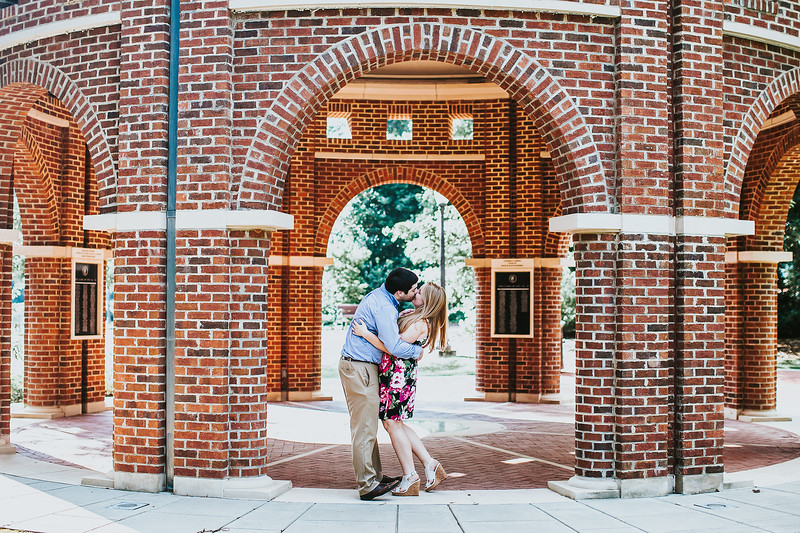 engaged couple kissing at Clemson