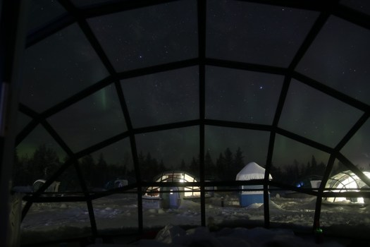 aurora from inside glass igloo in kakslauttanen