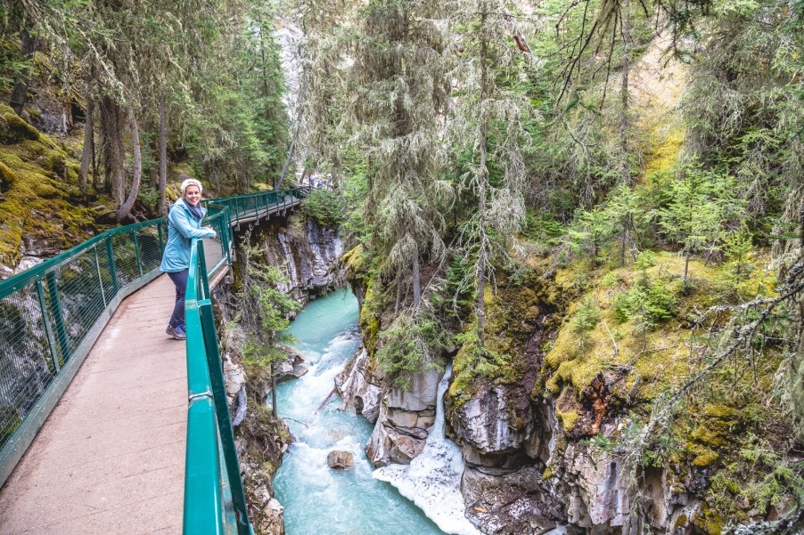 A trip to Banff, Canada is the ultimate nature's paradise. Don't miss a stop at Johnston Canyon for a casual hike along the water's edge. | www.eatworktravel.com - The luxury, adventure travel couple!