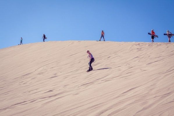 Looking for a unique activity in the Atacama Desert of Chile? Try desert extreme sports - Sandboarding in the death valley. | www.eatworktravel.com