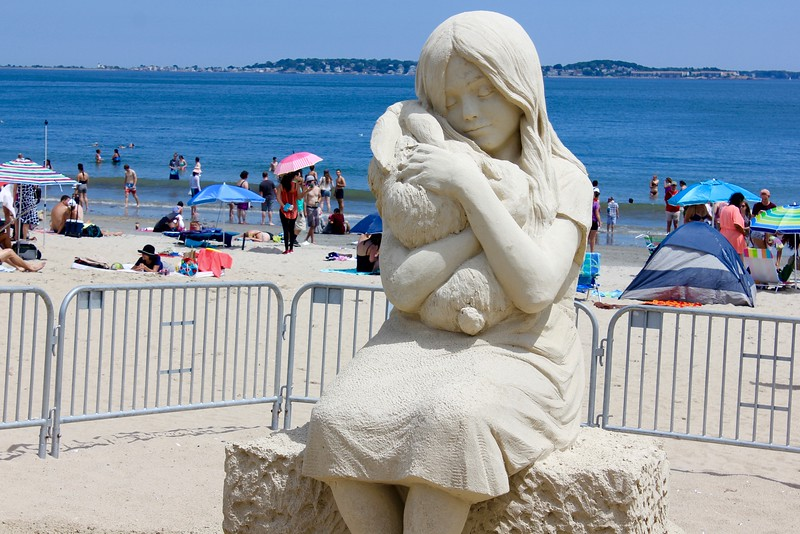 sand sculpture of girl and rabbit at Revere Beach international sand sculpting festival