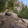 Gaining the ridge of Dragon's Back. Nice rocky terrain. Steep trail.