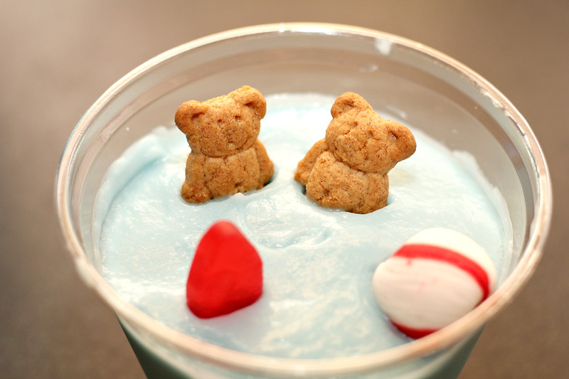 Add two Teddy Grahams, one Swedish Fish, and one round peppermint (beach ball) to the top of each pudding cup