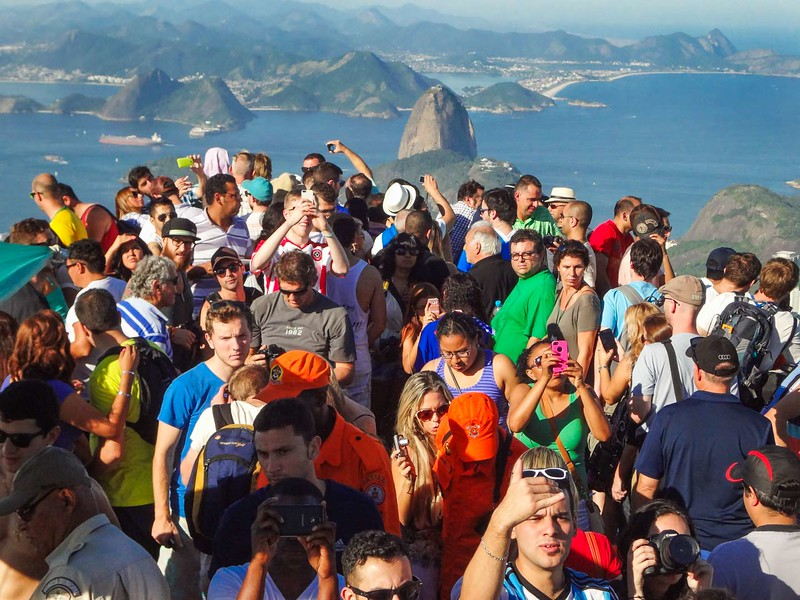 The Reality of Visiting Christ the Redeemer: Crowds of Tourists Fight to Take the Perfect Shot. Photo Credit: Renata Pereira