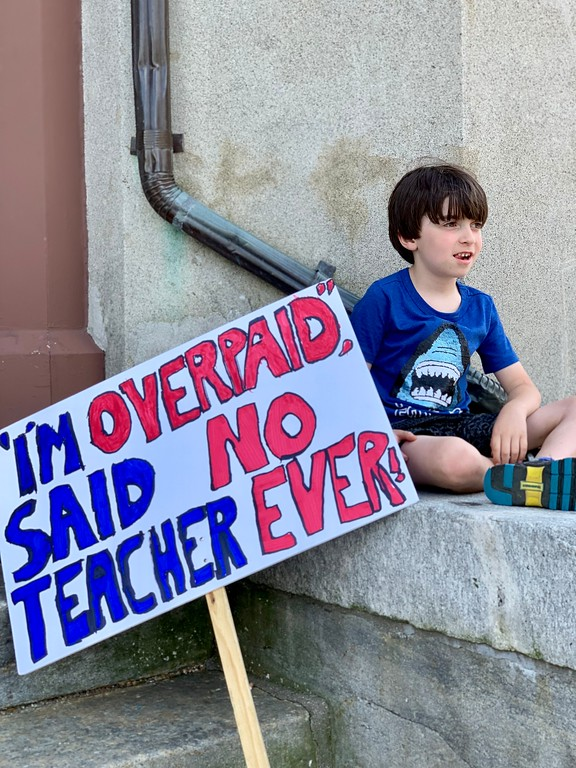 boy holding political sign