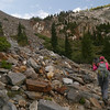 WE start up through the boulders on the left side of the white outcropping below the false pass. There is good use trail.