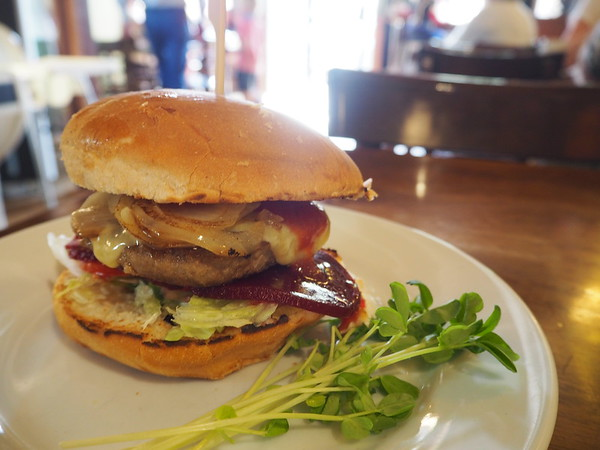Burger with beetroot, grilled onion, cheese, sauce - just the thing after riding to Gunning