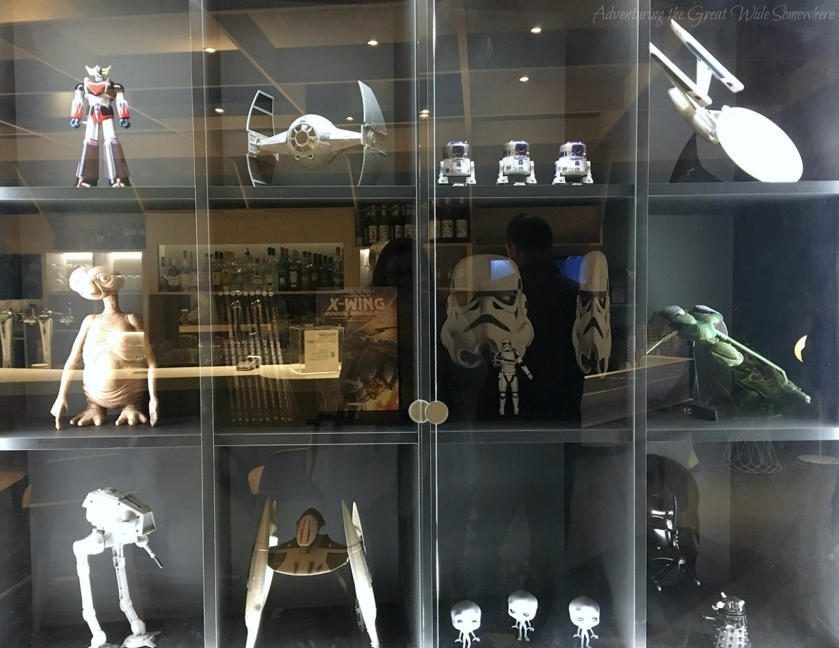 A super cute collection of science fiction knickknacks in the lobby of the outer-space themed airport hotel Ibis Styles CDG. Paris, France.