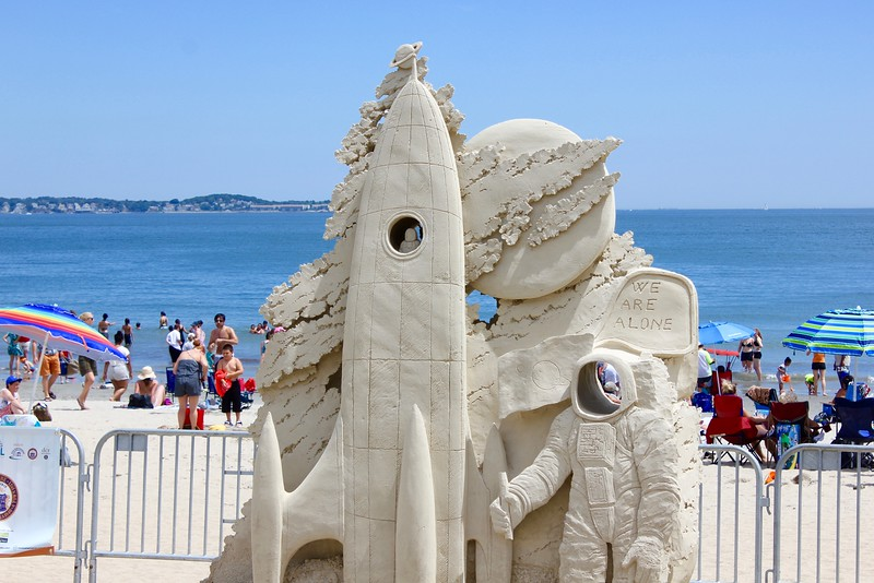 sand sculpture of space shuttle and astronaut at Revere Beach international sand sculpting festival