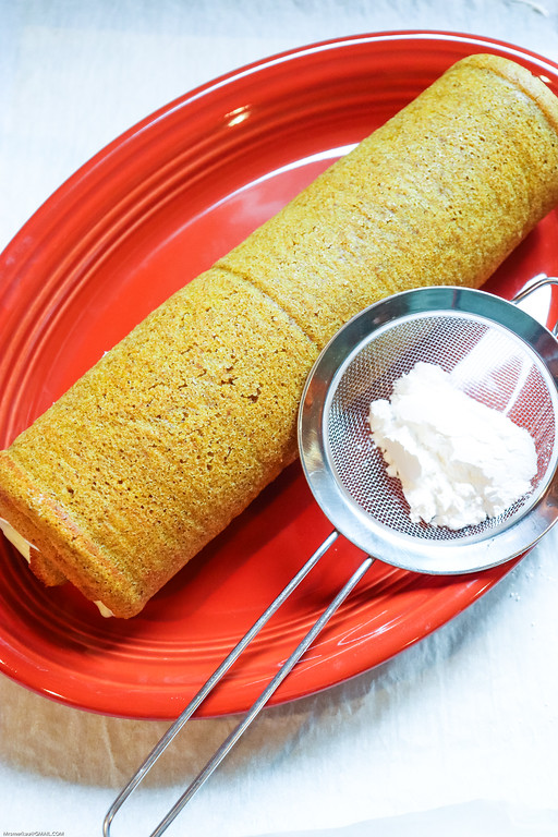 This delicious Pumpkin Roll Recipe uses a spongy pumpkin cake roll and cream cheese frosting filling, and is your perfect recipe for fun fall get-togethers!