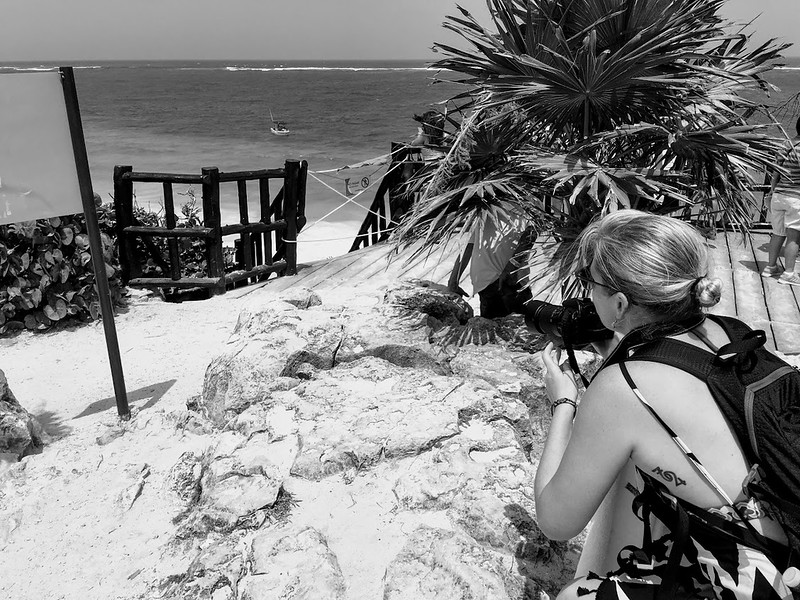 Tracy taking a photograph in Tulum