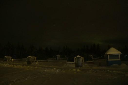 first signs of aurora in kakslauttanen lapland