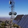 Summit radio towers and solar panels.