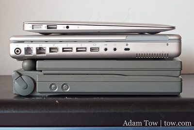 The new 11.6-inch MacBook Air on top of the 12-inch PowerBook G4 and the original PowerBook 100.