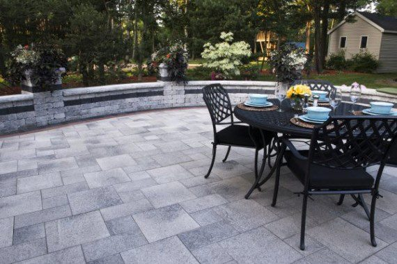 Umbriano paver patio with Brussels Dimensional wall by ... on Unilock Patio Ideas id=28783