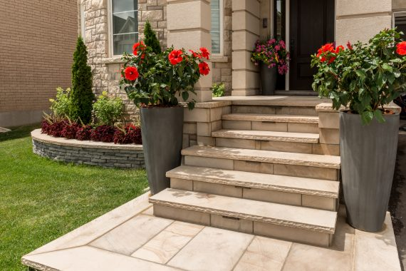 Front Entrance With Natural Stone Steps And Rivercrest