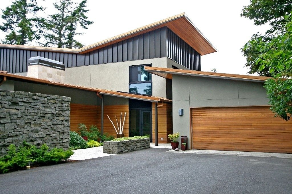 Modern Exterior of Home with Stacked stone wall & Metal ... on Modern House Siding  id=44406