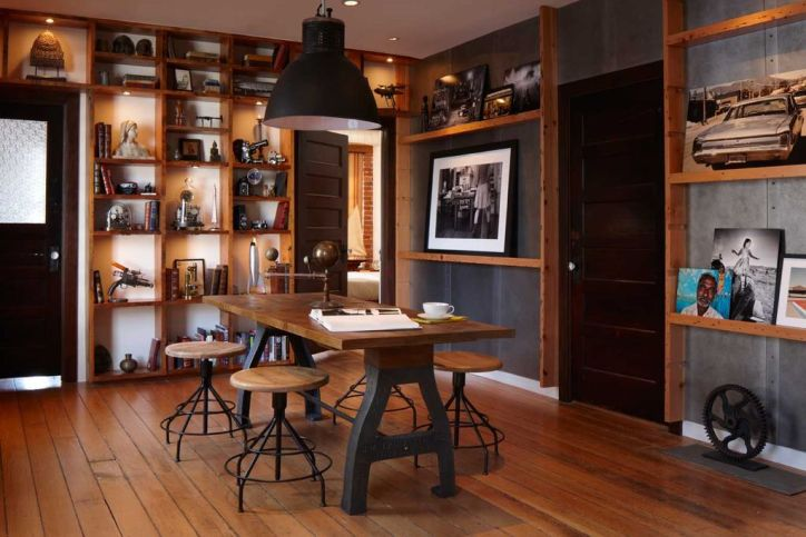 Steampunk Interior Design Dining Room with Wood Table Built In Bookshelves Industrial Accents