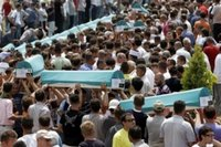 Bosnian people carry coffins of some of the 505 bodies to be buried during funeral ceremony at the Memorial Center Potocari, near Srebrenica north of the Bosnian capital Sarajevo, Tuesday, July 11, 2006. The bodies will be buried marking the 11th anniversary commemorations of the massacre. Serb troops killed over 8,000 Muslim men and boys at Srebrenica in 1995. (AP Photo/Amel Emric)