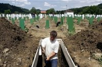 A Bosnian worker digs a grave during preparations for burial of 500 identified victims of the Srebrenica massacre at the Memorial Center Potocari, near Srebrenica, 120 km (75 miles) north of Sarajevo on Wednesday, July 5, 2006. The burial ceremony for 500 recently identified victims of the Srebrenica massacre exhumed from numerous mass graves is to be held on Tuesday, July 11. (AP Photo/Amel Emric)