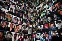 Portraits of Bosniaks, victims of the 1995 Srebrenica massacre, are displayed in the town of Tuzla. Photo: Reuters