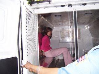 Katie in police transport van