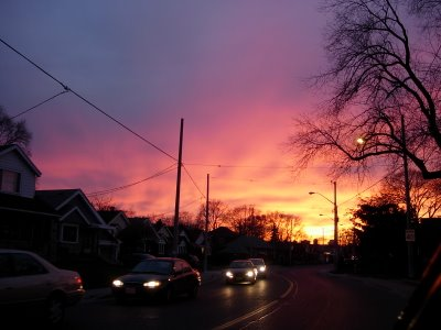 fiery red sunset over Toronto's dark streets