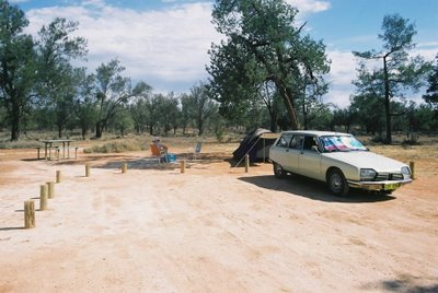 Car and tent in arid zone