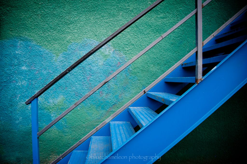 Subtle blue heart behind a vivid blue stairwell – photographed by Sharon (Vancouver Photography Meetup Group)
