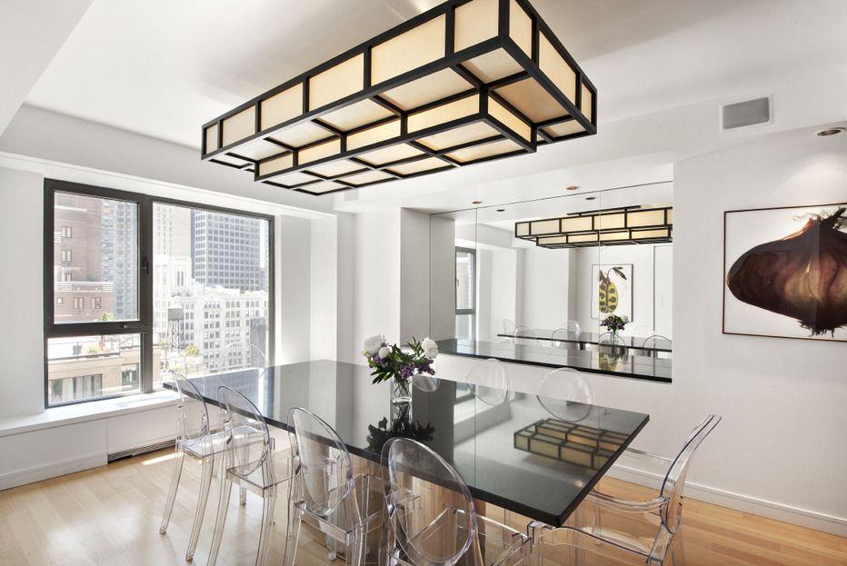 modern dining room with flush light window seat hardwood floors
