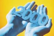 Hands holding the number '2000'