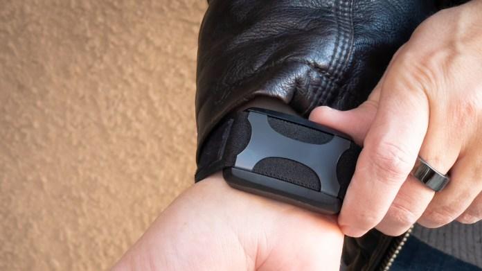 You can use the wearable's buttons to change intensity, pause, and start a session