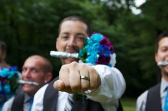 Groom holding Wedding Flowers