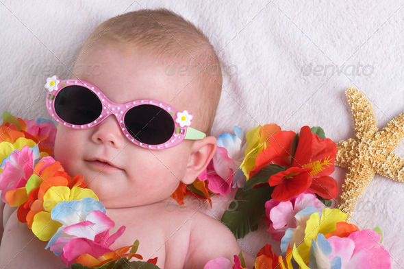 cute baby wearing glasses and flowers