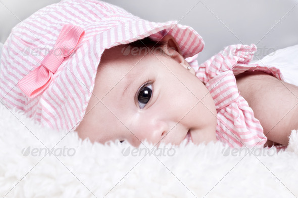 Baby lying down on a soft blanket