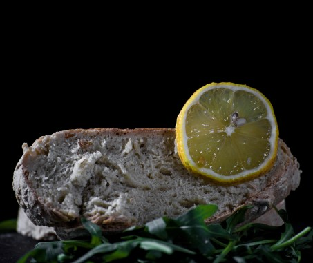 Food photography. Bread with vegetables on a black background.