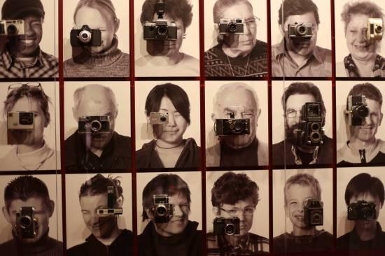Portrait matrix of 50 people holding cameras, Deutsches Technikmuseum,  Berlin