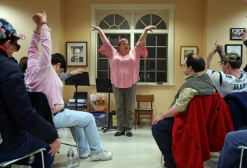 (Duxbury, MA 11/20/19) Eve Montague warms up members of the South Shore Voices Chorus during their practice at the South Shore Conservatory. (Boston Globe Photo by John Wilcox)
