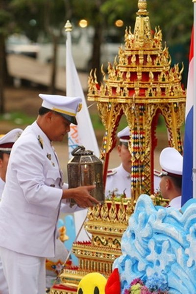 On Monday November 10th 2014, the Royal Flame of the 4th Asian Beach Games was carried from the Sports Authority of Thailand to leave the Suvarnbhumi Airport by Thai Airways International by on Flight TG215 at 14.10pm and arrived in Phuket at 15.30pm. Phuket Governor Nisit Chansomwong led a group of civil servants to have a great reception for the Royal Flame at the airport.  The Asian Beach Games Flame was then carried on a movable throne to head for Saphan Hin. The Flame was then located at the main stage there before a great celebration was held at 17.30pm.  In the evening, Phuket Governor Nisit Chansomwong brought the Royal Flame to be carried on the movable throne and was installed at the Phuket City Hall.  Tawichat Intararit, an official from the Phuket Provincial Culture Office as one of the Royal Flame Sub-Committee members, revealed that a Kathu sheriff on November 11 will lead civil servants in the district to receive the Royal Flame at the Phuket City Hall for a celebration across the district.  On November 12, there will be a torch run to celebrate the Royal Games Flame at Muang District and the following day at Thalang District before the Flame will be carried for an installation at the Saphan Hin Sports Center, where the opening ceremony of the 4th Asian Beach Games will take place on November 14.