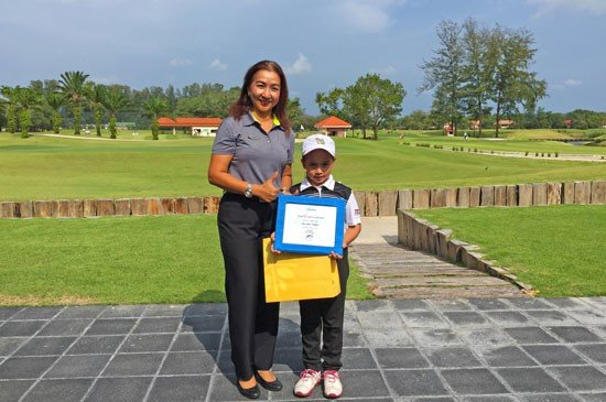 6-year old Louise Landgraf celebrates her ‪‎hole-in-one‬ at the par 3 hole #8, pictured receiving a special certificate and prize from Club Manager Walaiporn Pattamavichitvong.
