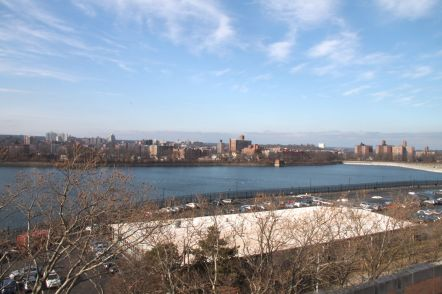 The view of the Bronx Reservoir from the roof top of Gillet Hall over looking the parking lot.
