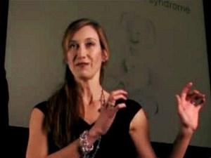 Dr. Julia Kinder speaking at a Conference