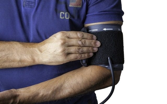 man taking his blood pressure physiotherapy cardiovascular disease CVD