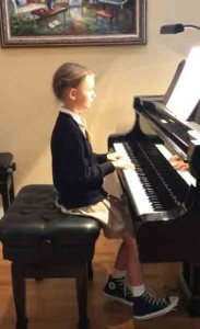 First year piano student playing Moonlight Mist.