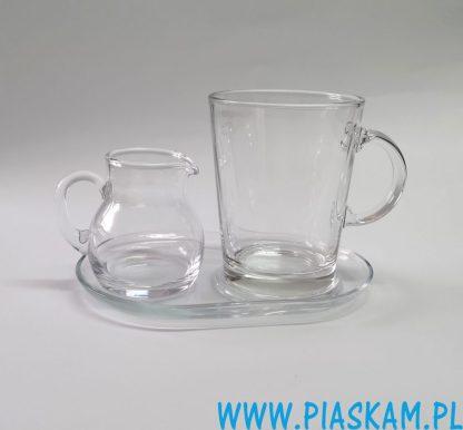 szklanka i spodek z mlecznikiem