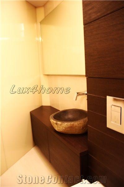 river stone sink producer bathroom